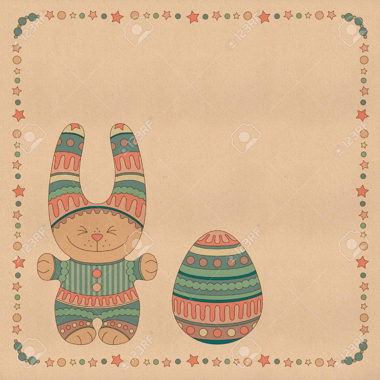 Ornamental bunny with a Easter Egg in a frame of stars and balls Stock Photo - 17088480