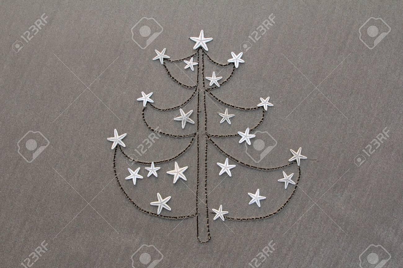 Original Christmas Tree Drawing on Sand Stock Photo - 50600247