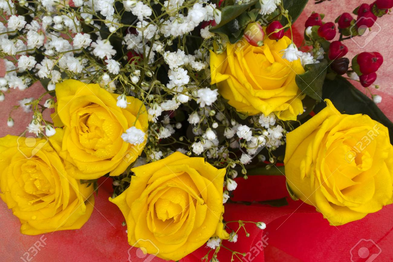 Beautiful Bouquet Of Yellow Roses And Small White Flowers On Stock