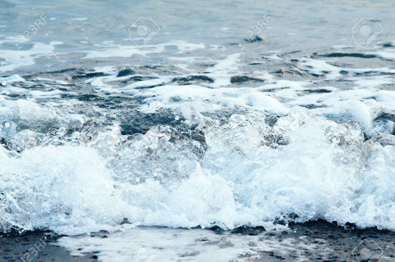 Blue frothing wave of the sea. Background close-up in a cold tone - 103505339