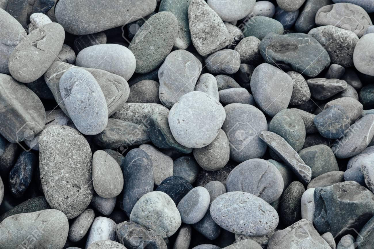 Gray stones close-up. Minimalistic beautiful background in gray tones. Pebble beach. - 103505345