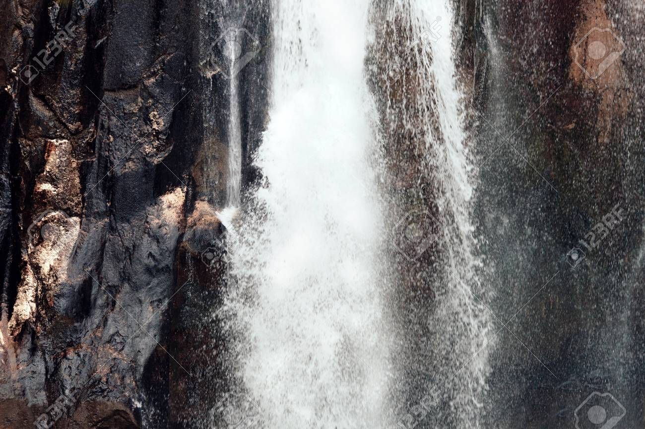 Close-up of a waterfall. Cinnamon tones. Beautiful background - 107192738