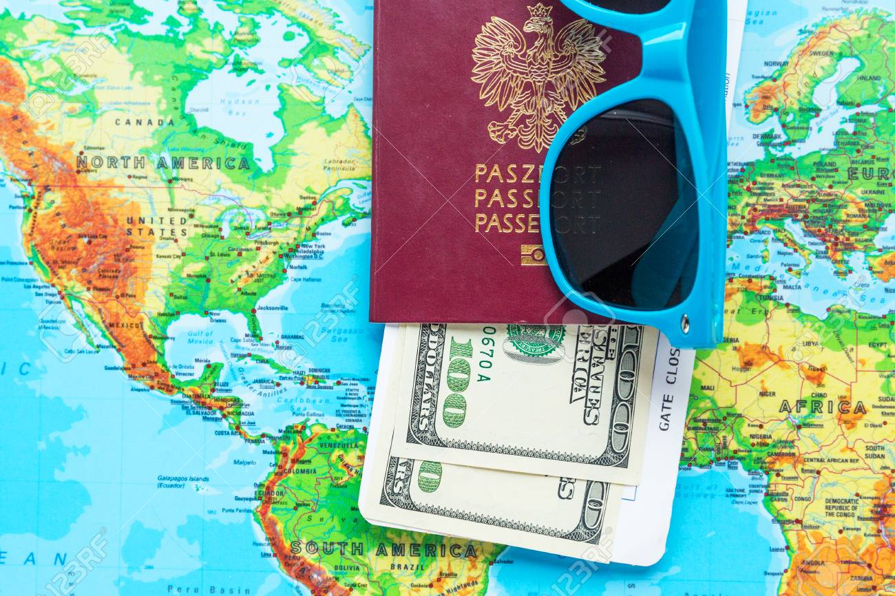 Polish biometric passport on the background of the World map...