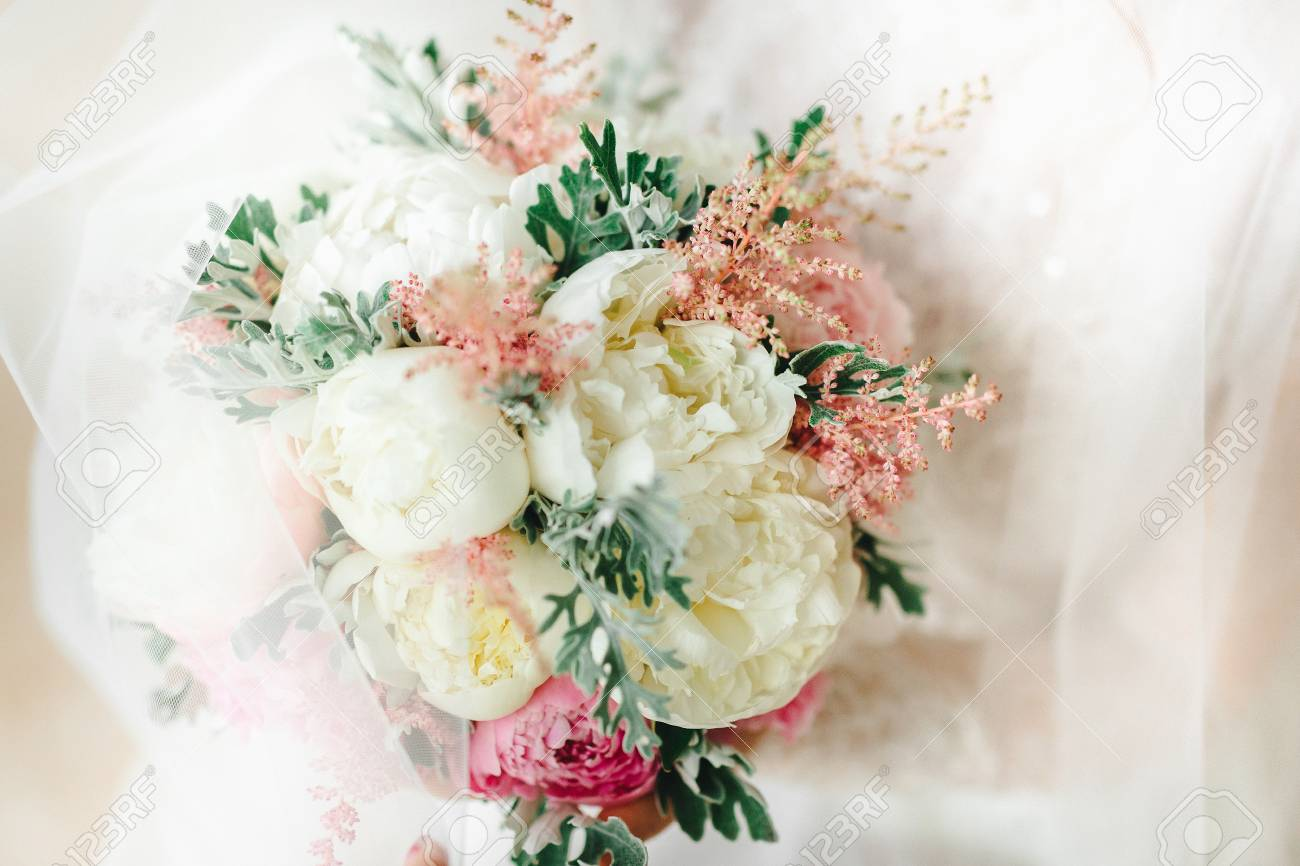 Wedding Bouquet With White And Pink Flowers In The Brides Hands