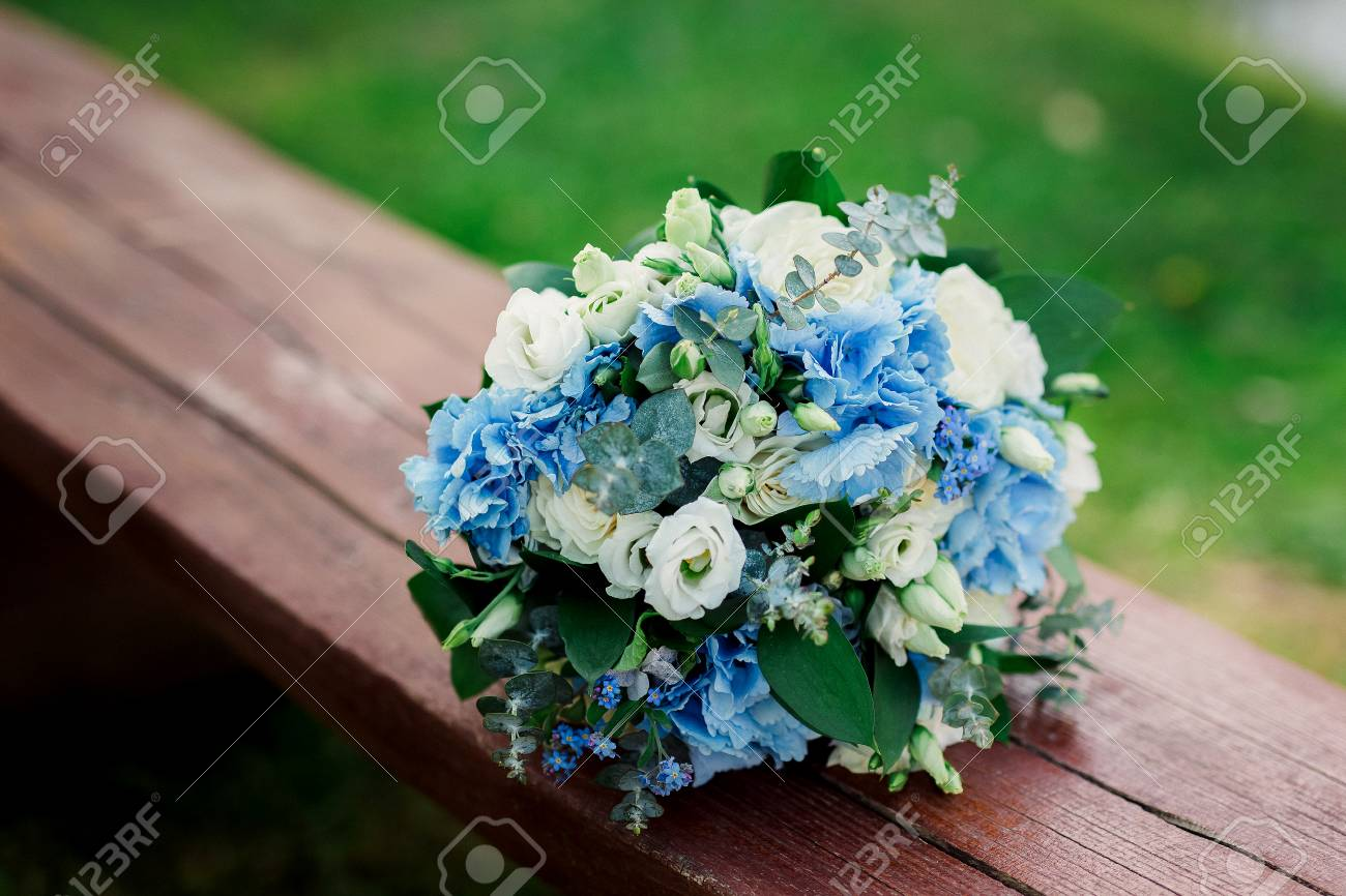 Beautiful Blue And White Fresh Flowers Wedding Bouquet Stock Photo
