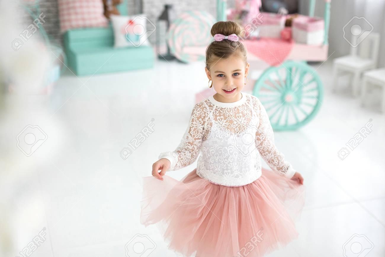 7eab86e4eafa Portrait Of A Beautiful Smiling Little Girl In The Studio Stock ...