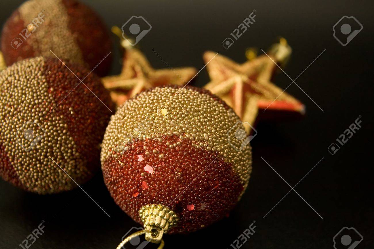 Red and gold christmas ornaments - Red And Gold Christmas Ornaments On Black Background Stock Photo 4001264