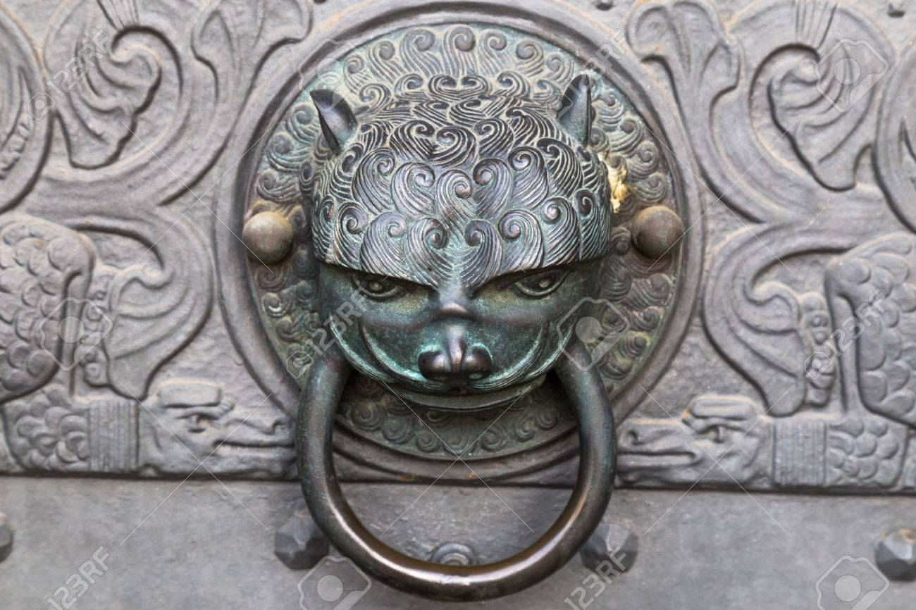 Stock Photo   Wrought Iron Vintage Door Knocker   Knob In The Form Of A Cat  Head