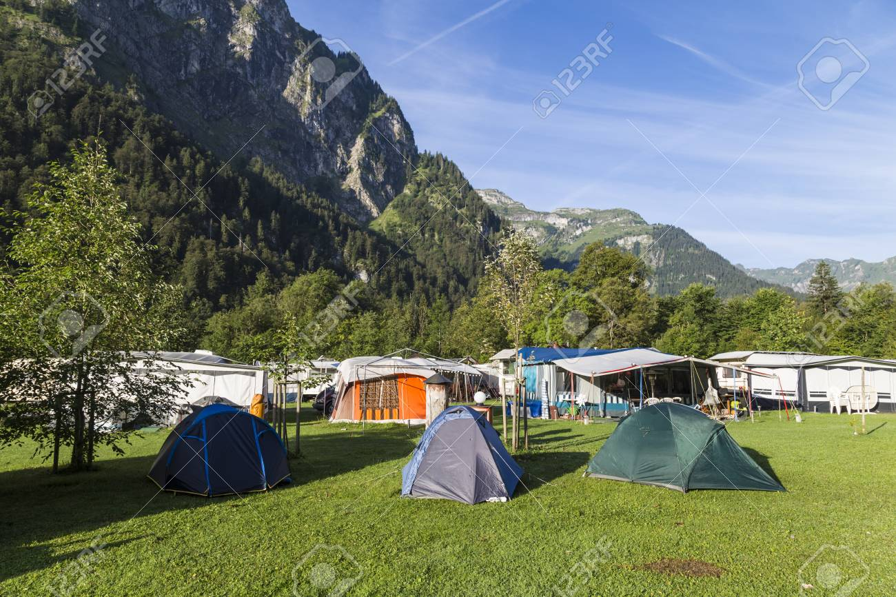 Camping In The Alpine Mountains Tourist Tents And Lodges In