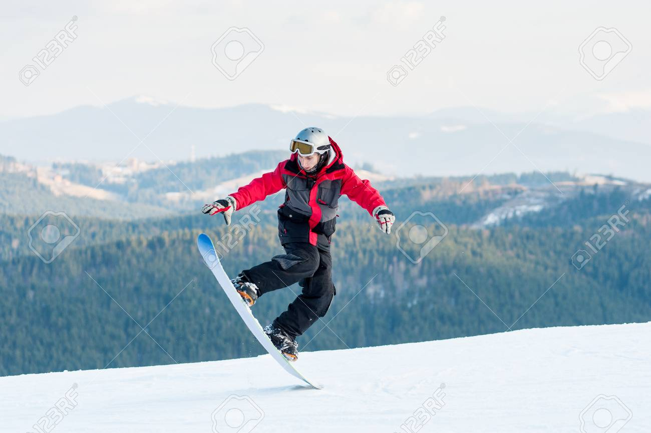Cool Man Snowboarder Riding On His Snowboard And Taking His For Stock Photo Picture And Royalty Free Image Image 70541242