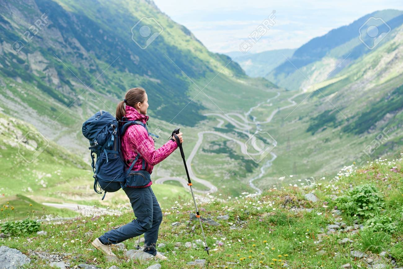 Hiking Trip In The Mountains Of Romania. Girl With A Backpack ...