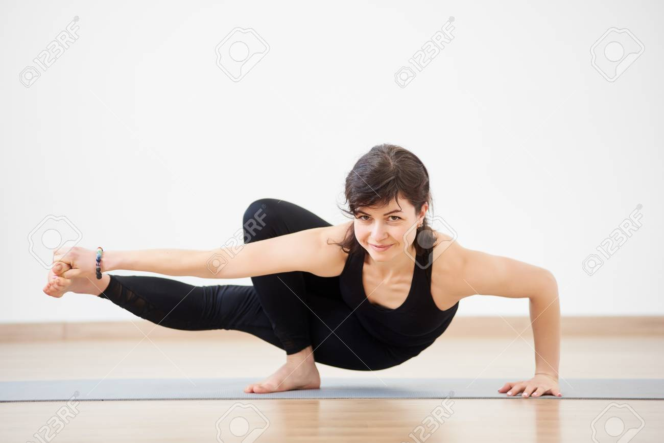 Athletic Strong Woman Smiling Practicing Difficult Yoga Handstand ...
