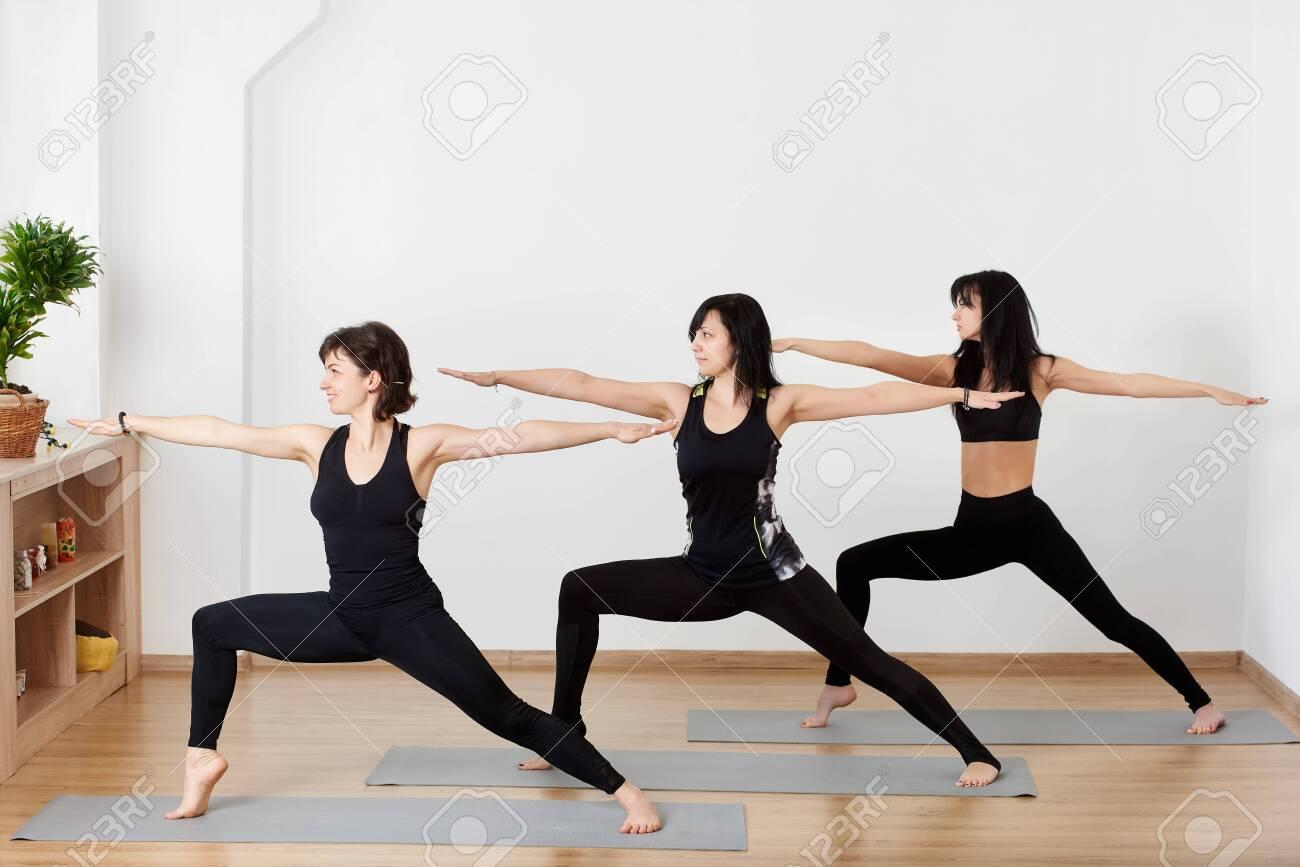 Beautiful Sporty Fit Women Practicing Ashtanga Vinyasa Yoga Asana Stock Photo Picture And Royalty Free Image Image 132452746