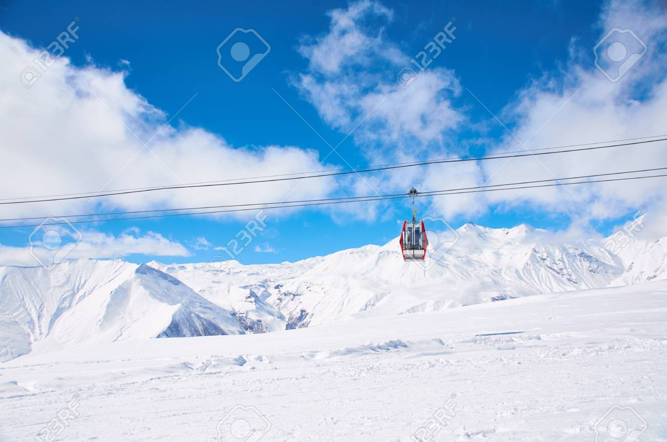 Cable car on ski resort with blue sky background. Concept of snowdoard  hobby. Place a0550e32dfb7