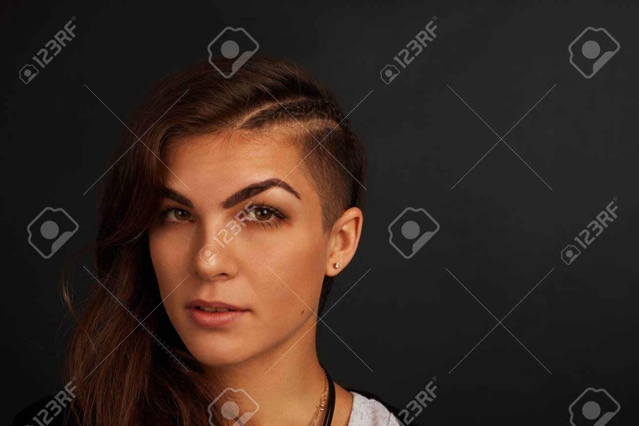 559c72d7741 Pretty girl with dark skin and stylish hairstyle. Brunette latin woman on  black background.