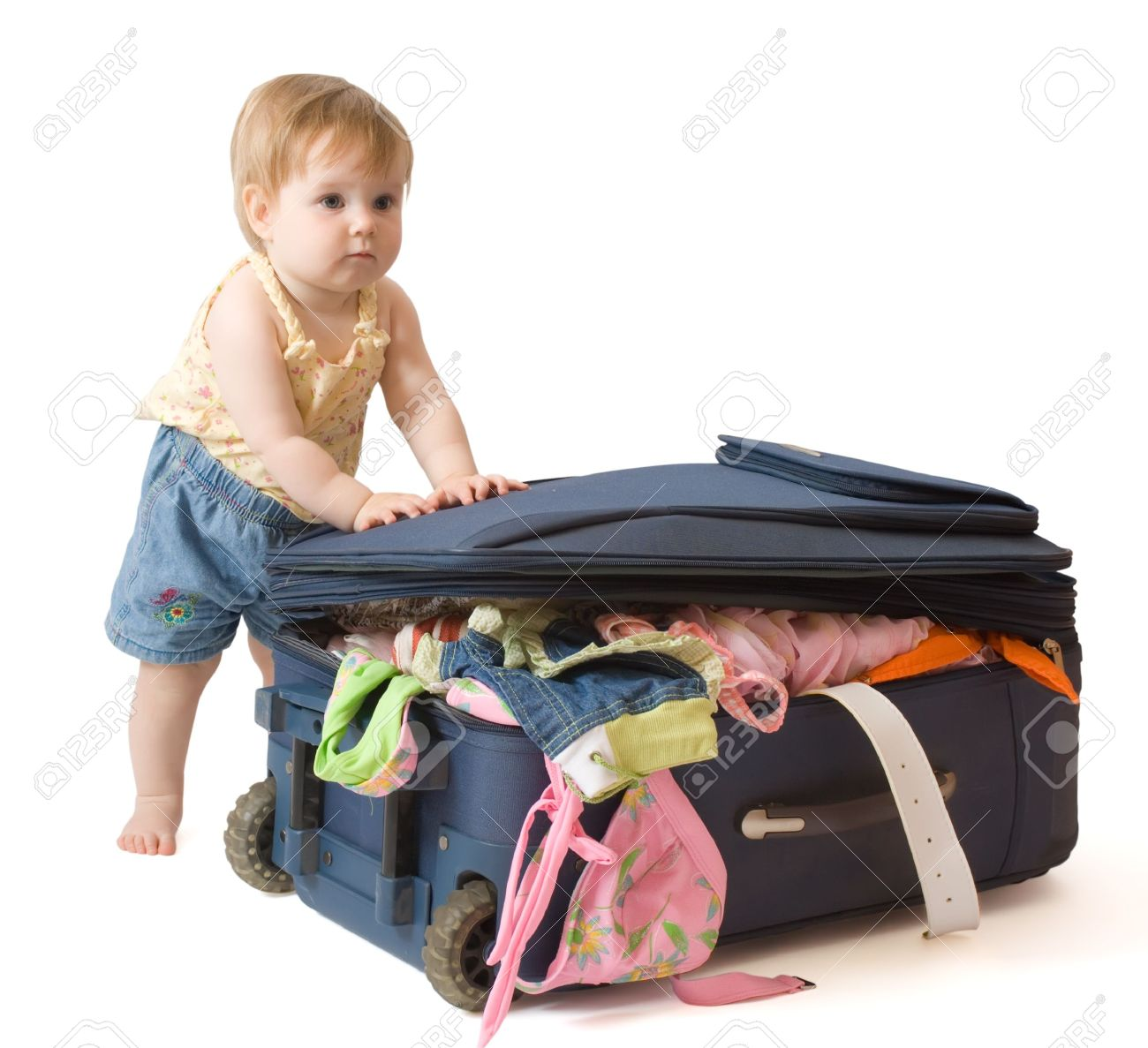 girl standing near the suitcase, trying to pack it, isolated, with clipping path Stock Photo - 3254405