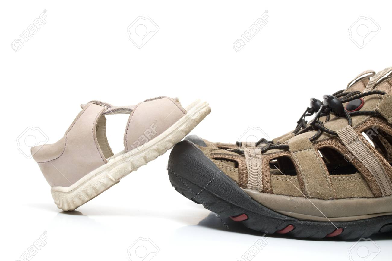 Small  sandal stepping on huge adult shoe, isolated, on white background Stock Photo - 3393823