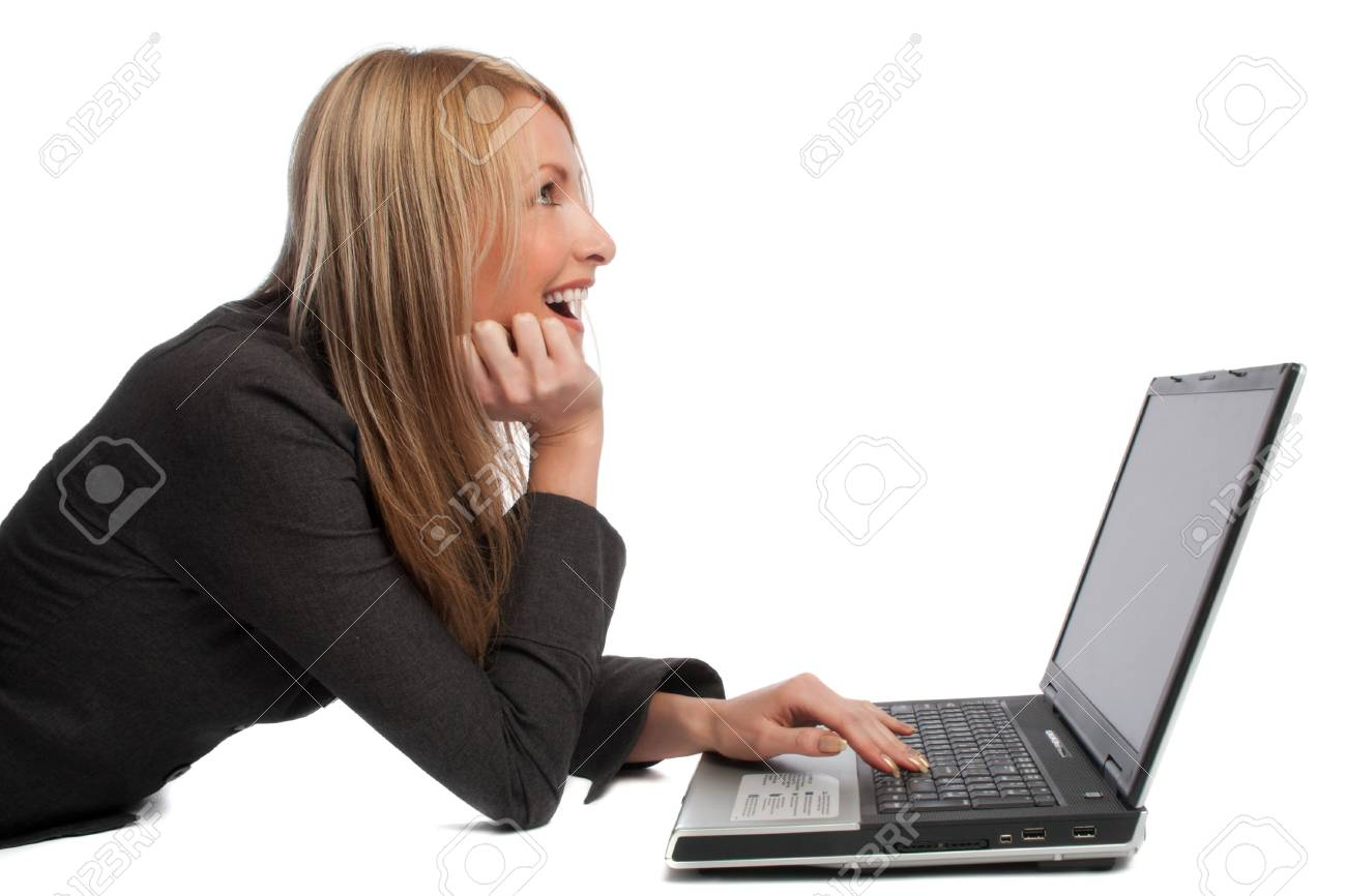 Laughing young girl with laptop, looking up, isolated Stock Photo - 3671930