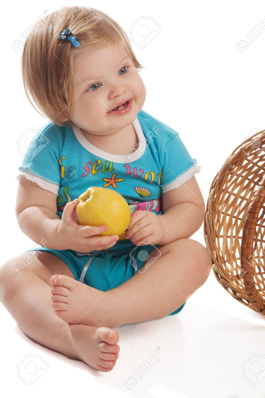 Smiling girl holds an apple, isolated Stock Photo - 3939704