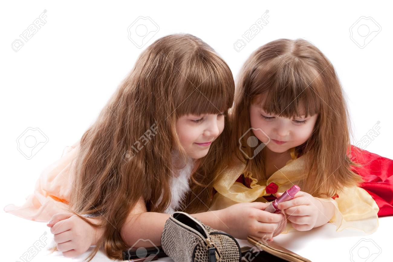 Little sisters examining cosmetics, isolated Stock Photo - 4057774