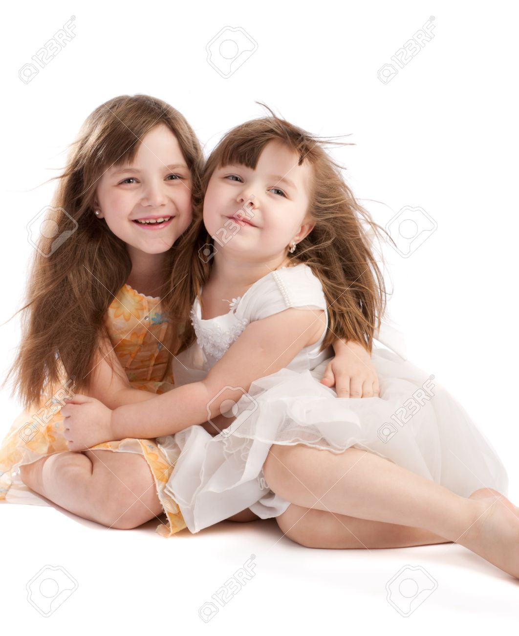 Two Little Sisters Isolated Stock Photo Picture And Royalty Free Image Image 4071313