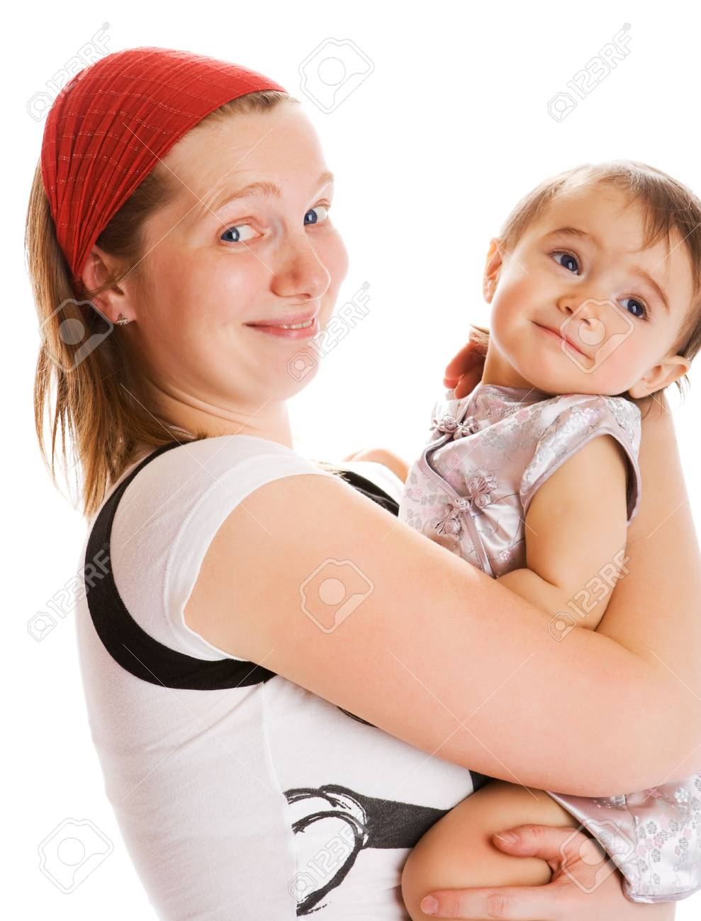 Happy mother holding her daughter in hands Stock Photo - 5047531