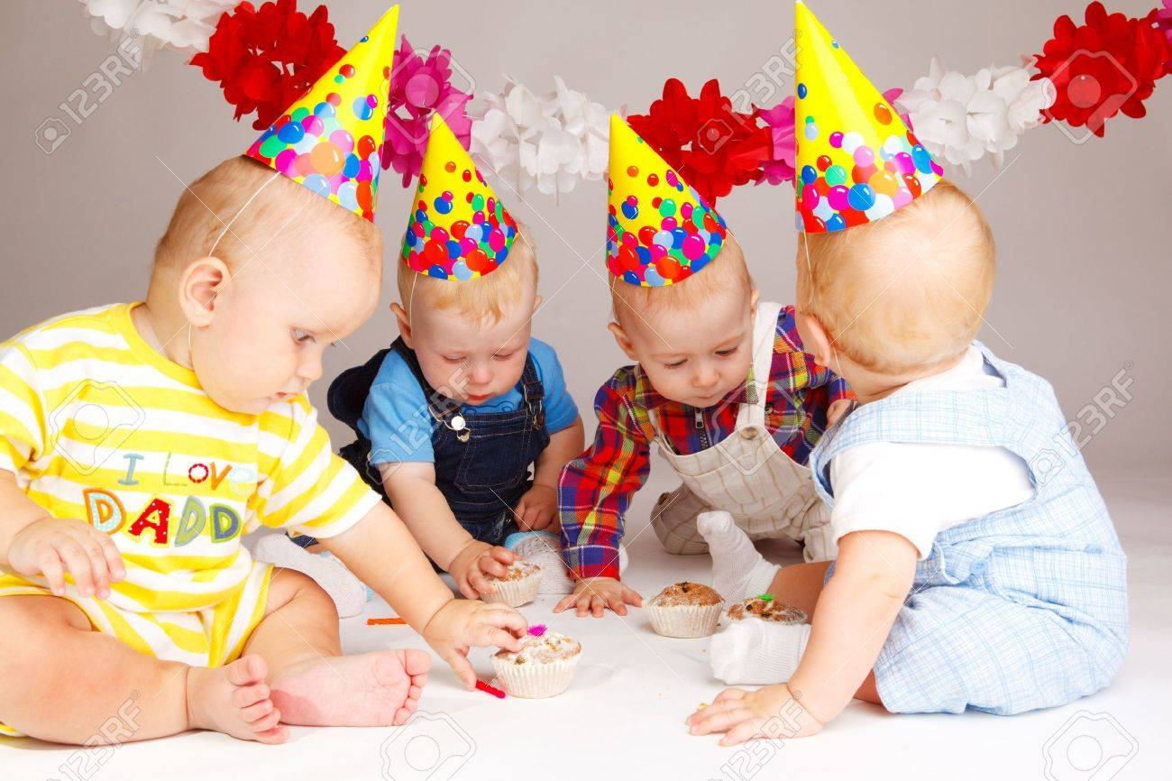 Four babies taking their birthday cakes Stock Photo - 5526883