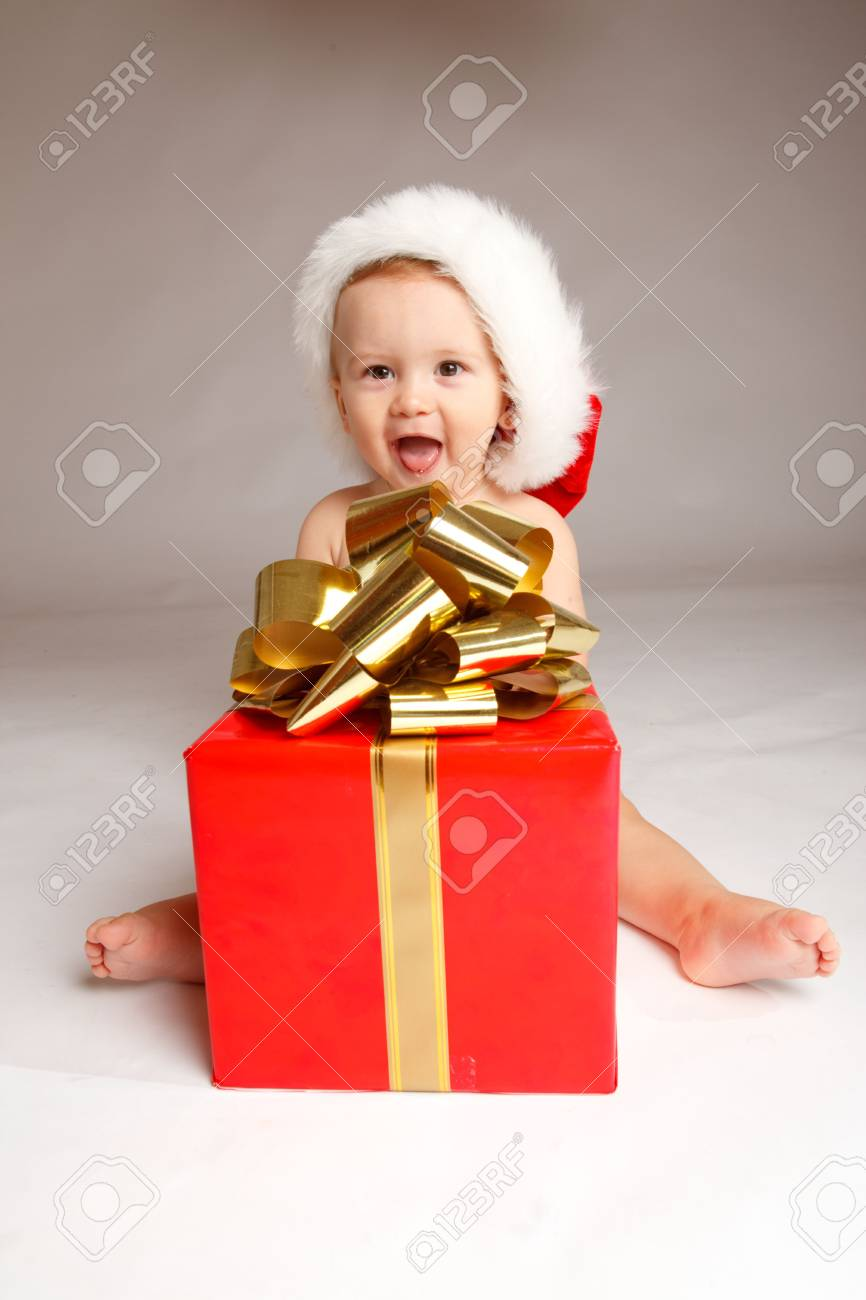 Baby boy sitting with Christmas present Stock Photo - 5706004