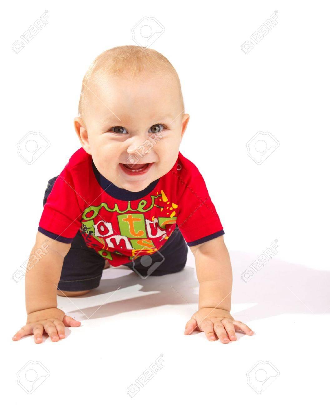 Laughing baby boy crawling, isolated Stock Photo - 5730137