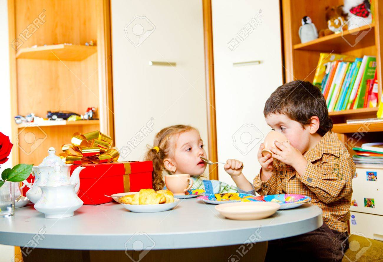 Two little friends having tea with cookies Stock Photo - 5815368