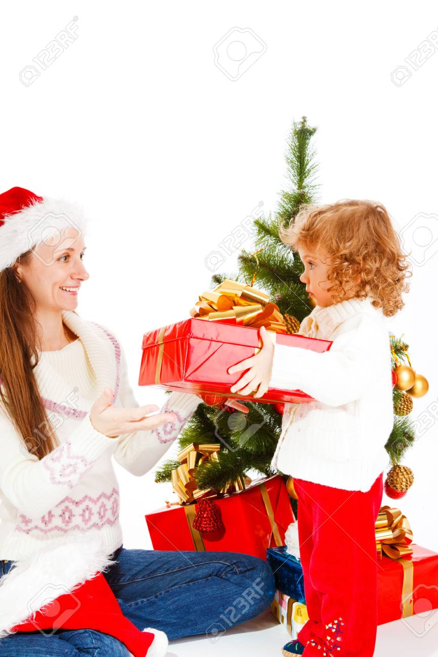Cute little girl giving her mom  opening a Christmas present Stock Photo - 5880160