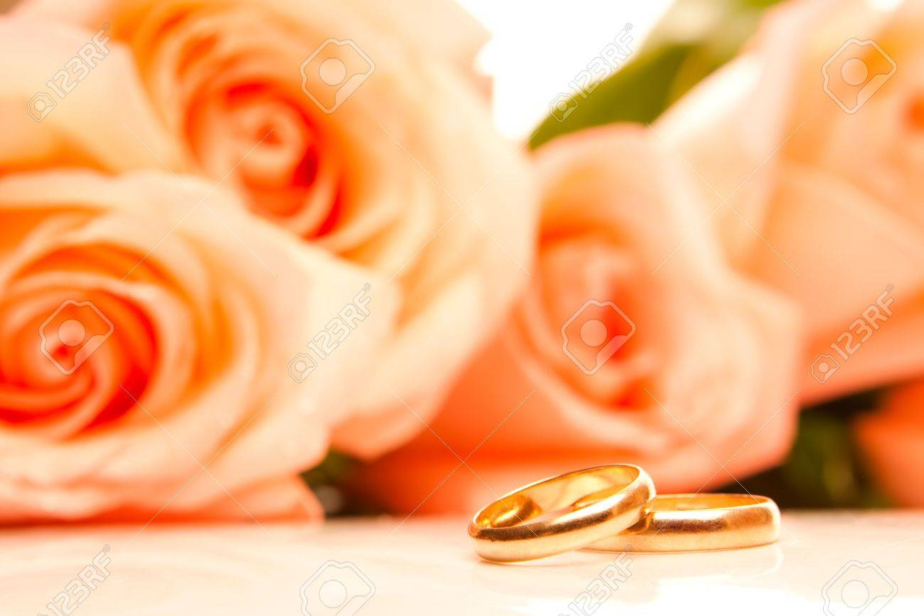 Orange Flowers With Wedding Rings Stock Photo Picture And Royalty