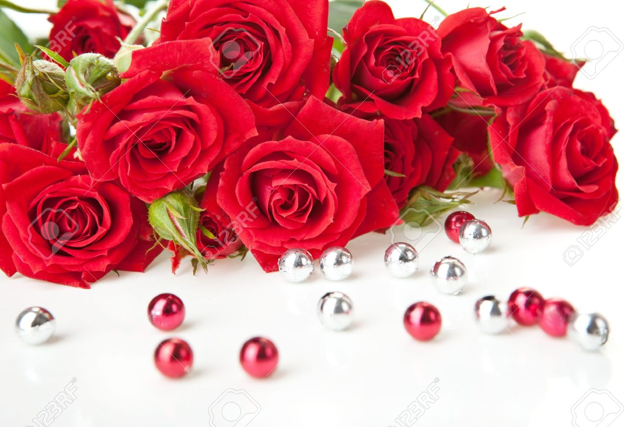 red roses bouquet and beads on white background stock photo, picture