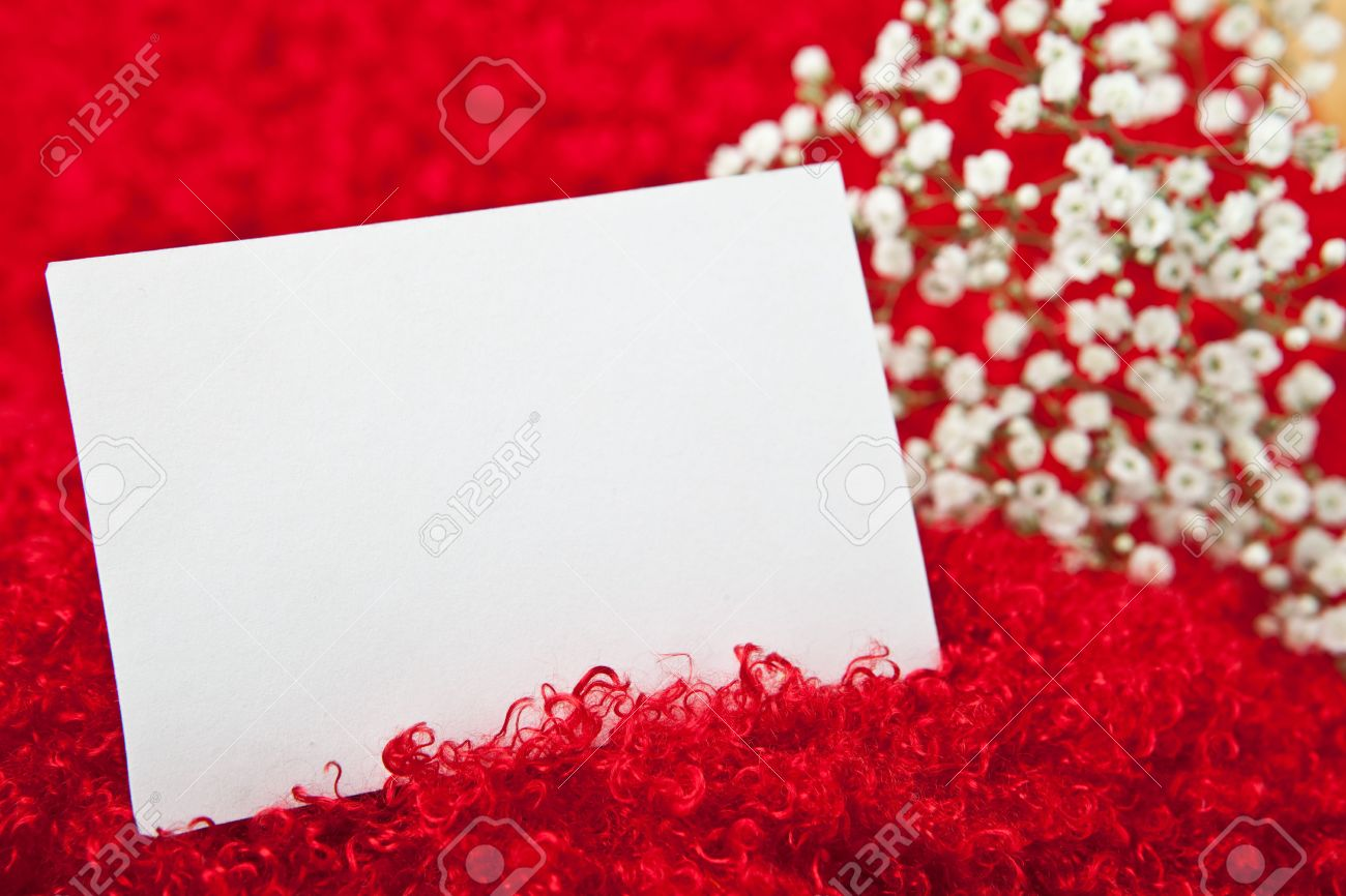 Blank Invitation Card In White Flowers On Shaggy Red Fabric Stock