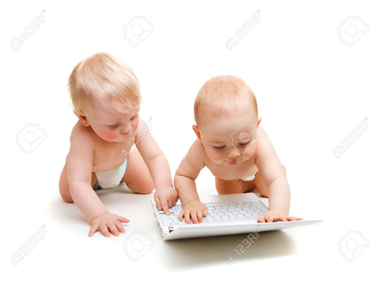Two modern baby boys with laptop, isolated Stock Photo - 6367978