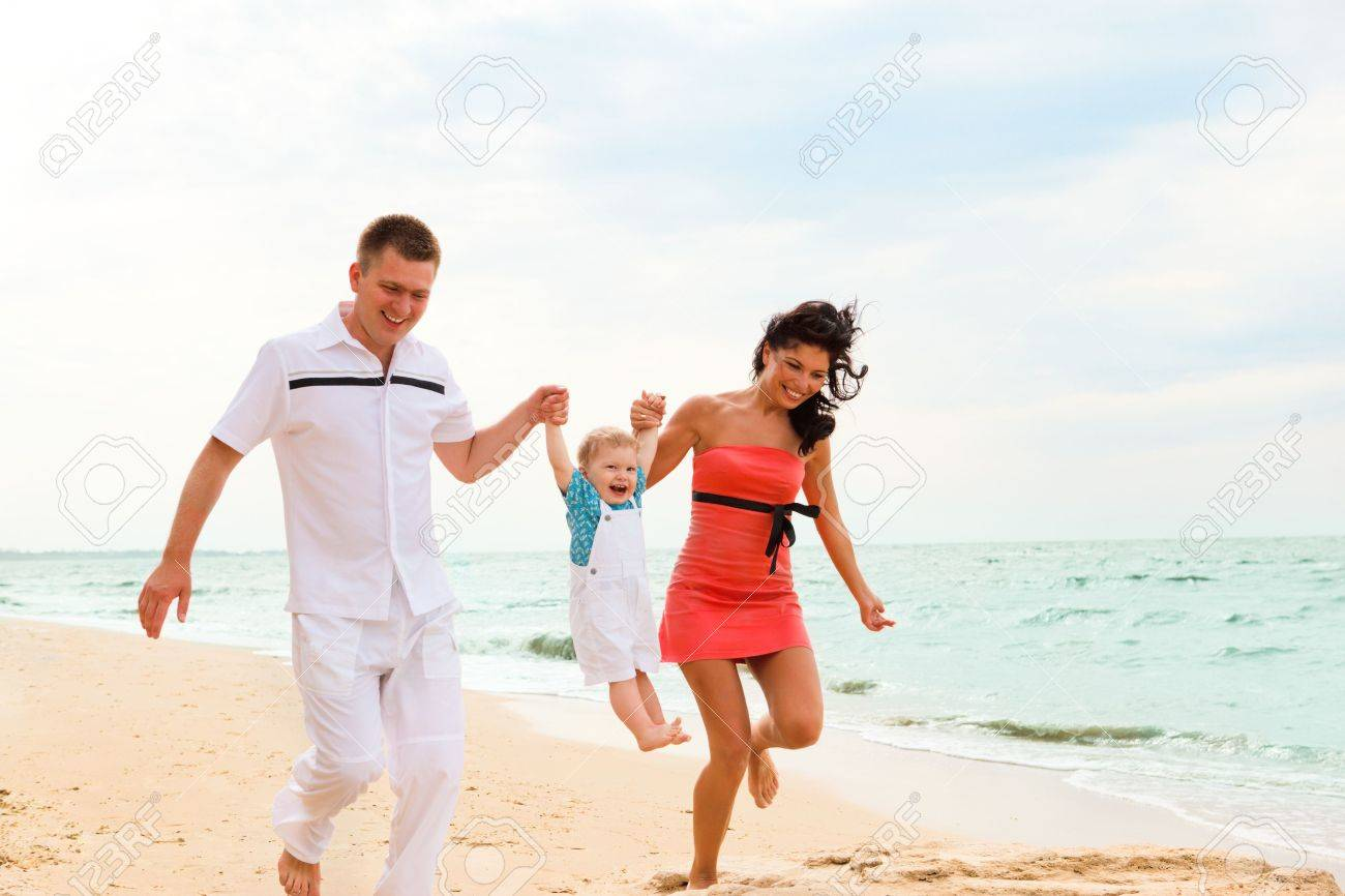 Attractive young parents playing with their little son Stock Photo - 6553749