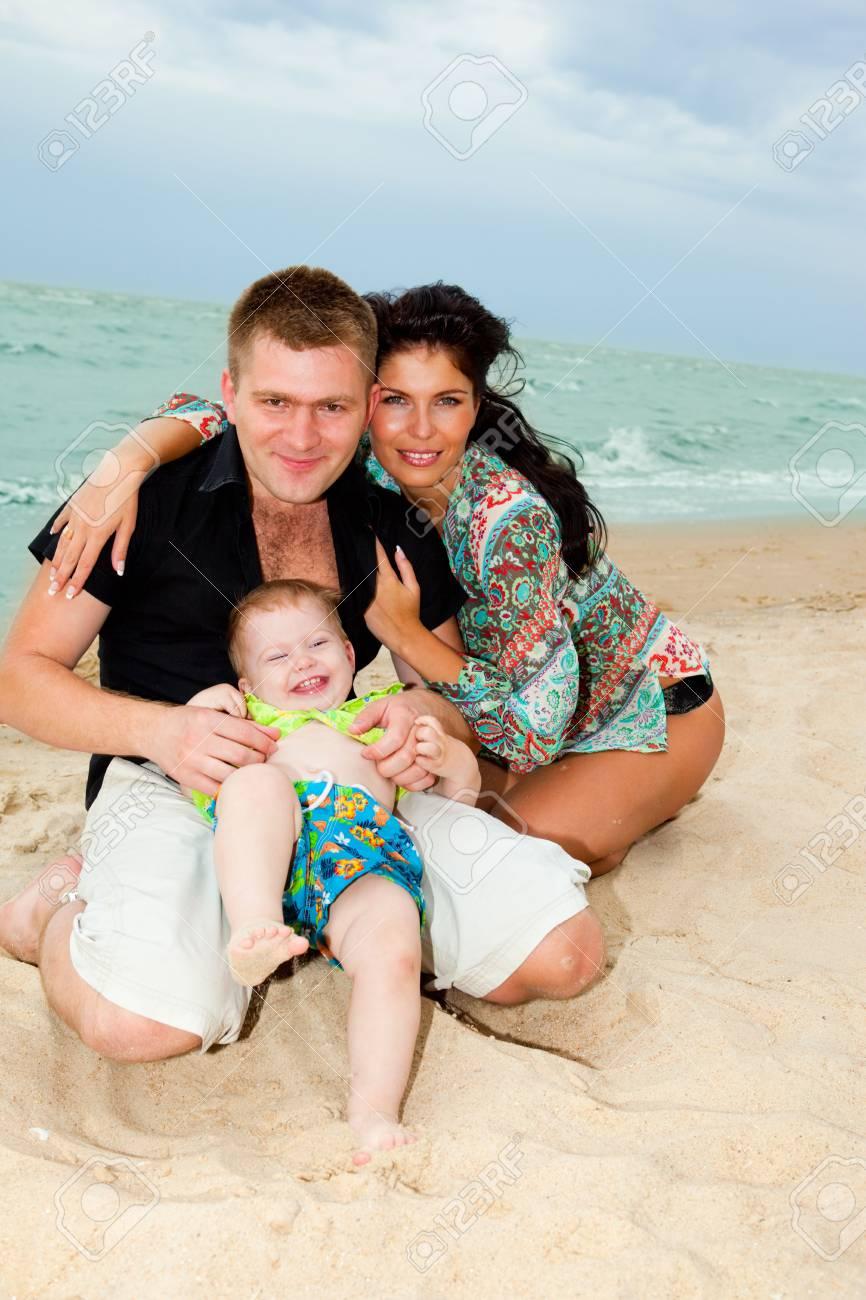 Happy family of three at the beach Stock Photo - 6838646