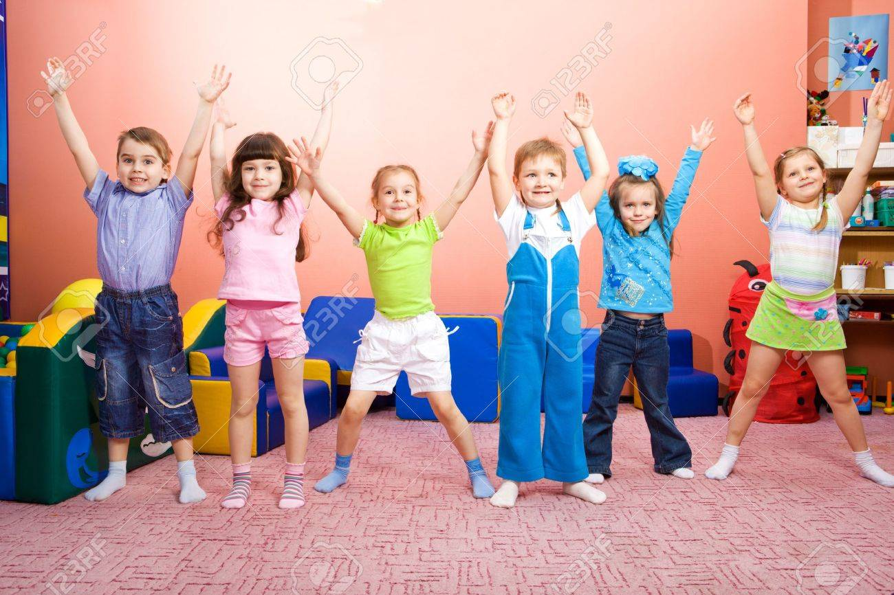 Several joyful kids with their hands up Stock Photo - 7020889
