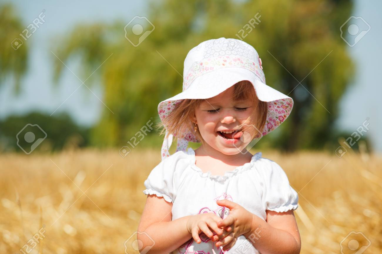 Portrait of a pleased little girl with her mouth out Stock Photo - 7367483