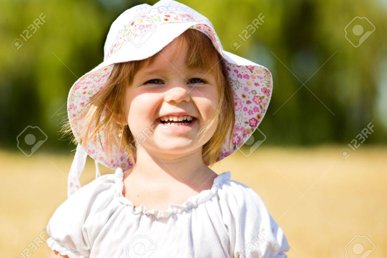 Pleased little girl in wheat Stock Photo - 7498422