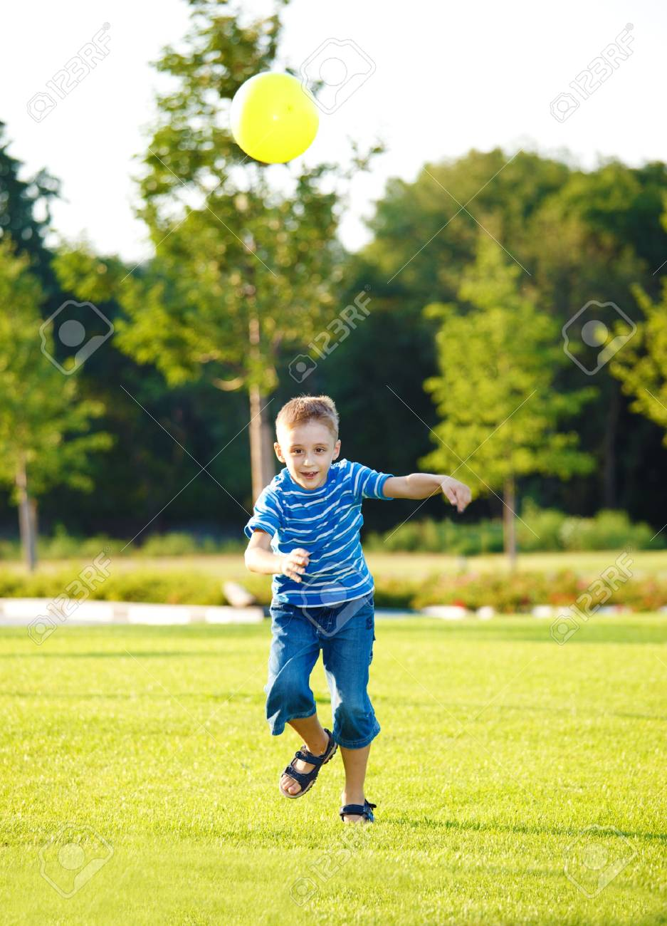 Boy running with the ball Stock Photo - 7613279