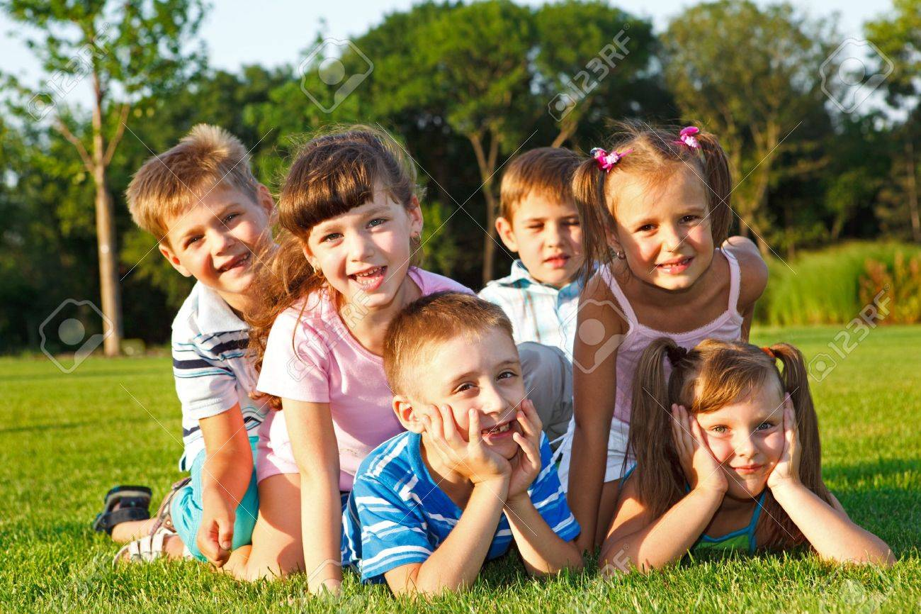 six excited preschool friends in the backyard stock photo picture