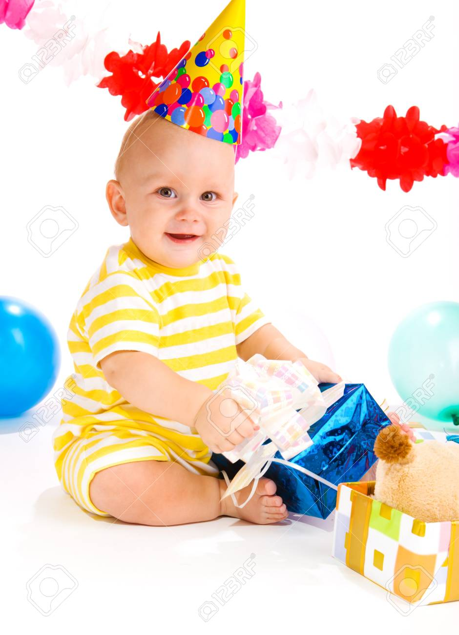 Baby in a party hat happy to receive a present Stock Photo - 7712747