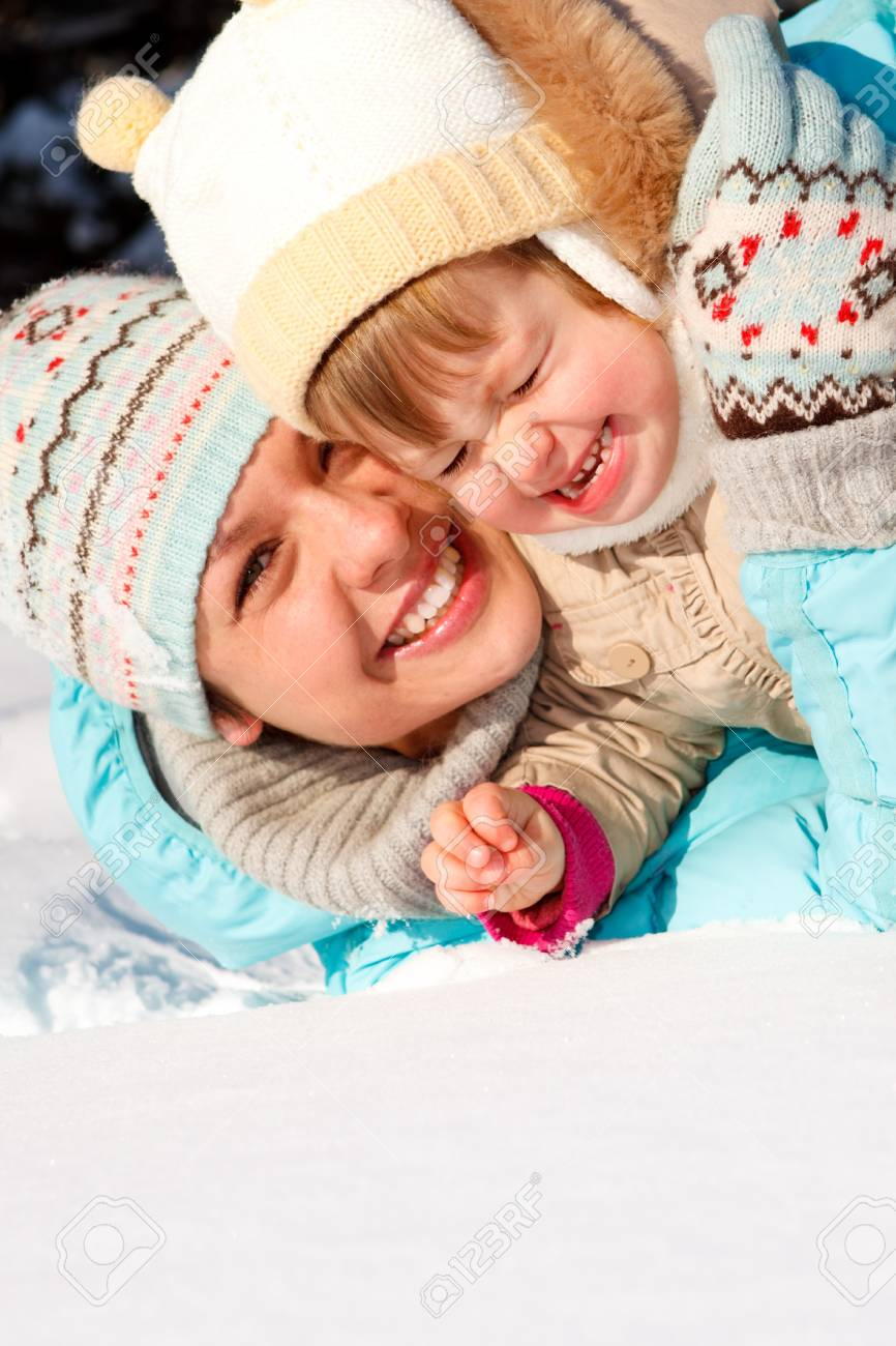 Mom and daughter playing in snow Stock Photo - 7706407