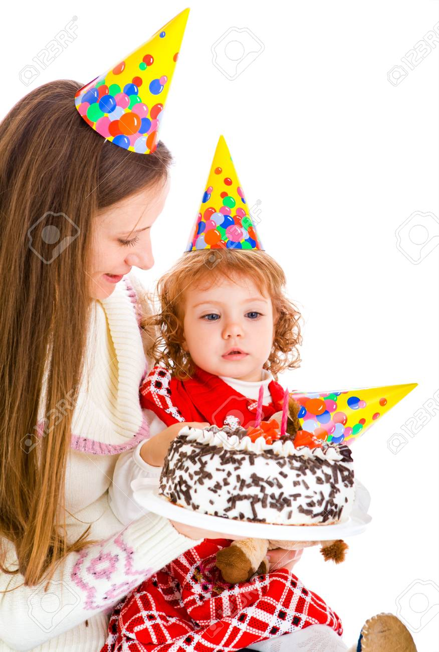 Little girl looking at her birthday cake Stock Photo - 7872194