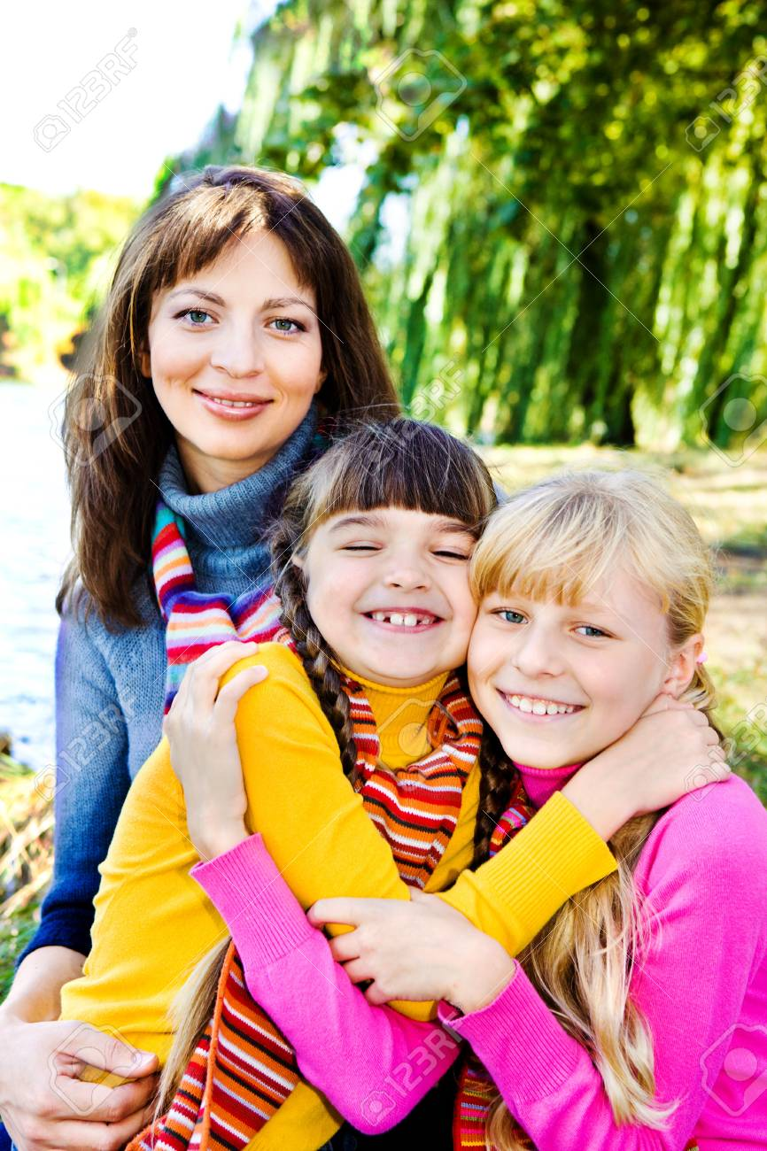 Happy sisters and their mother behind Stock Photo - 7955213