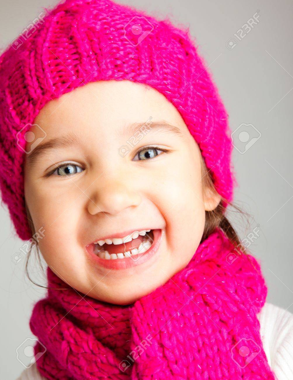 Excited preschool girl in knitted hat and scarf Stock Photo - 7955201