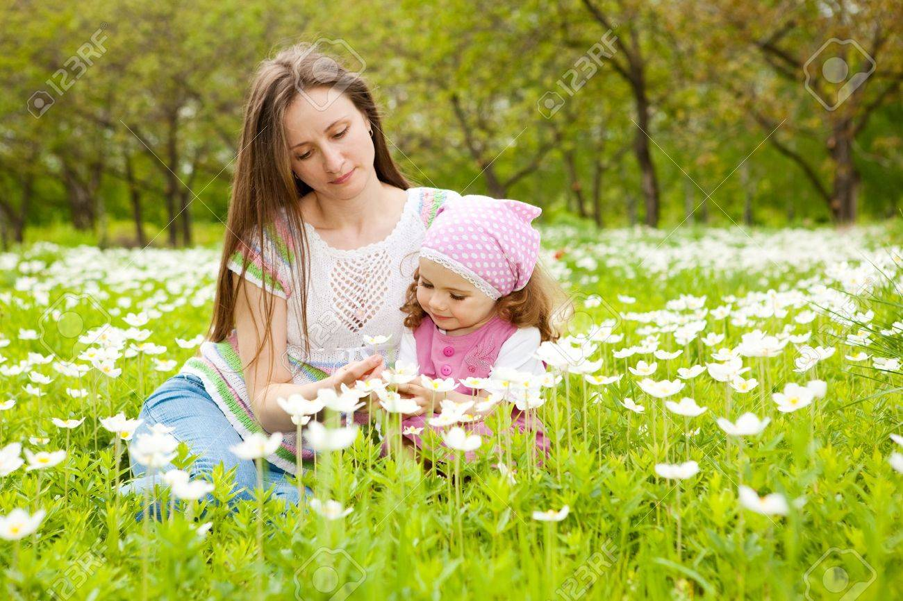 Happy mother and daughter among white flowers Stock Photo - 8013301