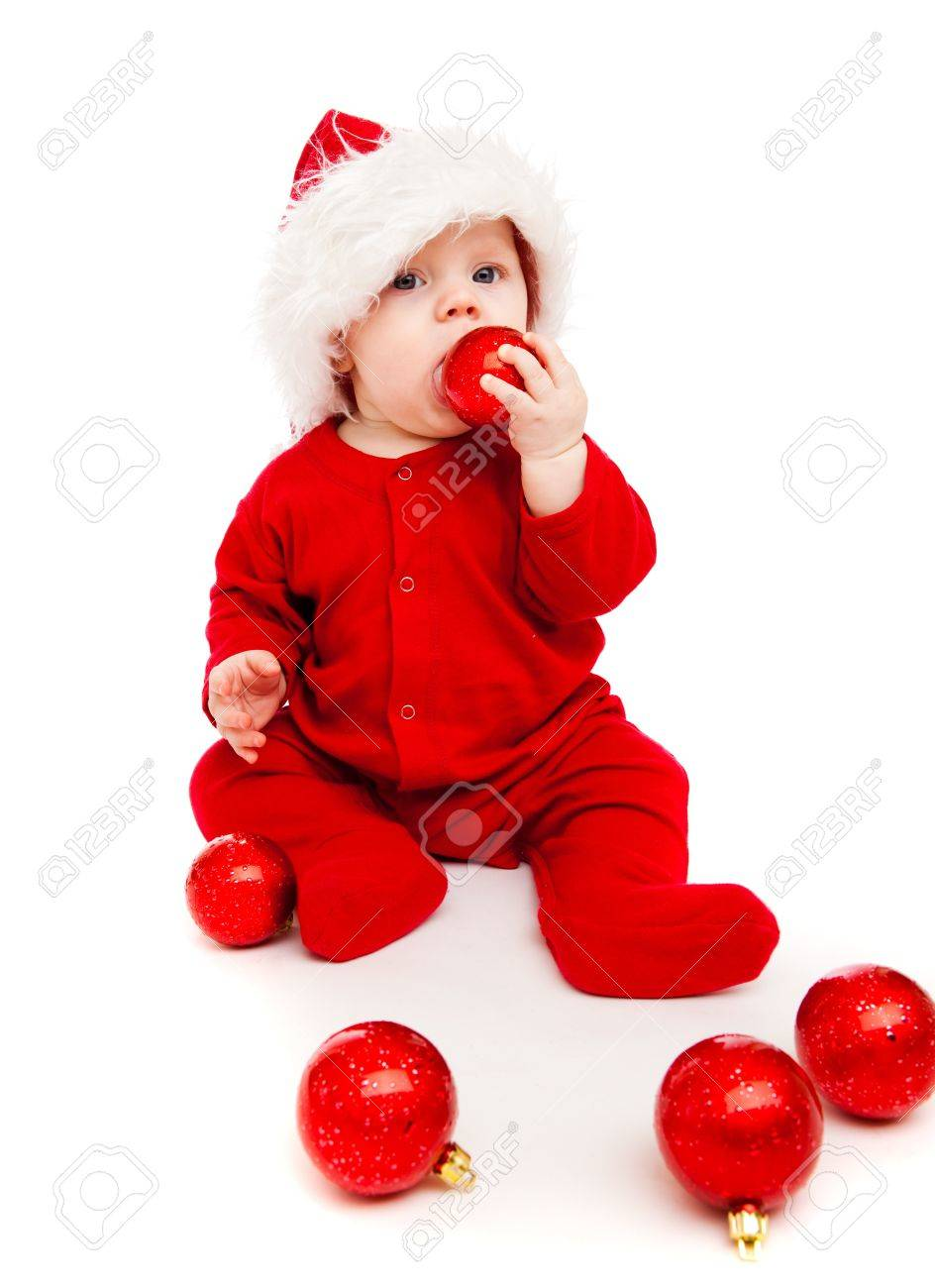 Gorgeous baby playing with red Christmas balls Stock Photo - 8168581
