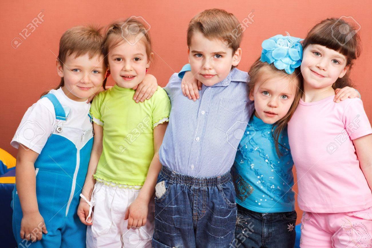 Group of attractive preschool kids embracing Stock Photo - 8168613